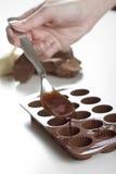 Making Raw Organic Chocolate. Woman making raw organic chocolate confectionery Royalty Free Stock Photos