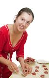 Woman making russian meat dumplings (pelmeni) Royalty Free Stock Image