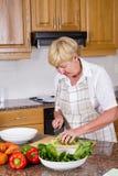 Woman making salad Stock Photo