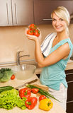 Woman making salad Stock Images