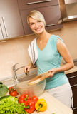 Woman making salad Stock Photography