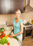 Woman making salad Stock Image
