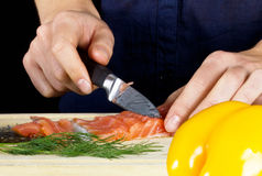 Woman making salad in kitchen Stock Photography