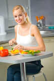 Woman making salad at kitchen Royalty Free Stock Image