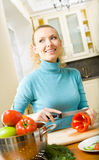 Woman making salad at kitchen Royalty Free Stock Photo