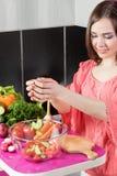 Woman making salad Stock Image