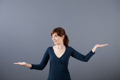 Woman making a scale. With her arms Royalty Free Stock Photo