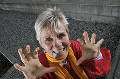 Woman making scary gesture  Stock Photos