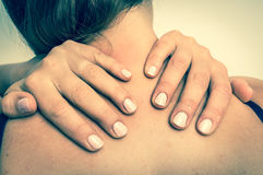 Woman making self massage of her neck - retro style Stock Photography