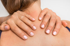 Woman making self massage of her neck Royalty Free Stock Images