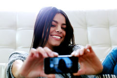 Woman making self photo with her smartphone Stock Photo