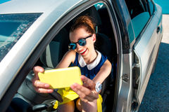 Woman making self portrait in the car Stock Photo
