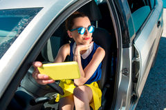 Woman making self portrait in the car Stock Photos