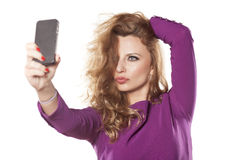 Woman making selfie Royalty Free Stock Photo