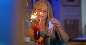 Woman making selfie with cocktail and sparkler stock video footage