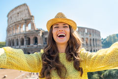 Woman making selfie in front of colosseum in rome Royalty Free Stock Photos