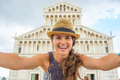 Woman making selfie in front of duomo di pisa Stock Images