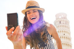Woman making selfie in front of tower of pisa Stock Photography