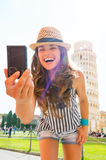 Woman making selfie in front of tower of pisa Royalty Free Stock Photos