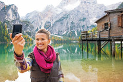 Woman making selfie on lake braies in south tyrol Royalty Free Stock Image