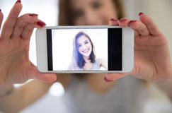 Woman making selfie photo on smartphone Royalty Free Stock Image