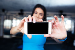Woman making selfie photo on smartphone Stock Image