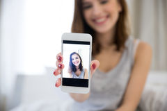 Woman making selfie photo on smartphone Stock Image