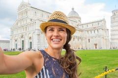 Woman making selfie on piazza dei miracoli, pisa Royalty Free Stock Photos