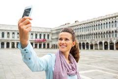 Woman making selfie on piazza san marco in venice Stock Photos