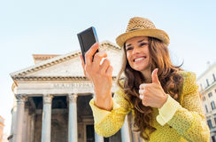 Woman making selfie and showing thumbs up  in rome Royalty Free Stock Images
