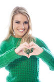 Woman making the shape of a heart with her hands Royalty Free Stock Photos
