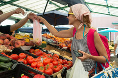 Woman making shopping at green market Stock Photos