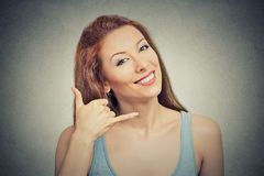 Woman making showing call me gesture sign with hand Royalty Free Stock Image