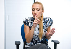 Woman making shush sign Stock Photos