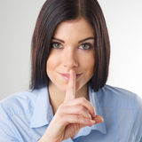 Woman making a shushing gesture Royalty Free Stock Photography