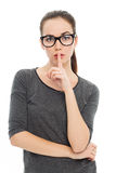 Woman making silence gesture Stock Photography