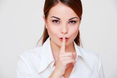Woman making silence sign Stock Photography