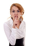 Woman making silence sign. Pretty woman making silence sign over grey background Royalty Free Stock Photography