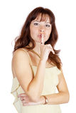 Woman making silence sign Royalty Free Stock Photography