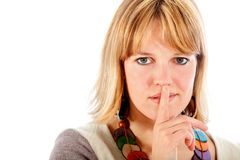 Woman making a silence signal Stock Images