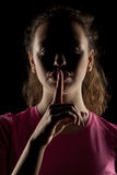 Woman making silent gesture Stock Photos