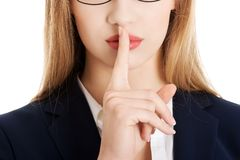 Woman making silent gesture Stock Photography