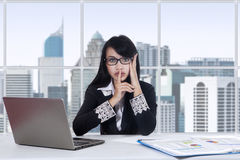 Woman making silent sign in the office Royalty Free Stock Photo