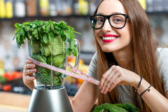 Woman making smoothie Stock Photography