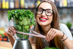 Woman making smoothie Royalty Free Stock Photography