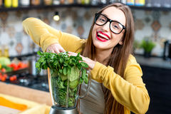 Woman making smoothie Stock Photo
