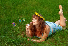 Woman Making Soap Bubbles Stock Images