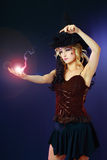 Woman making spell with magic fireball Royalty Free Stock Image