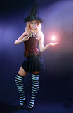 Woman making spell with magic fireball Royalty Free Stock Photo