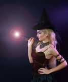 Woman making spell with magic wand Royalty Free Stock Photos